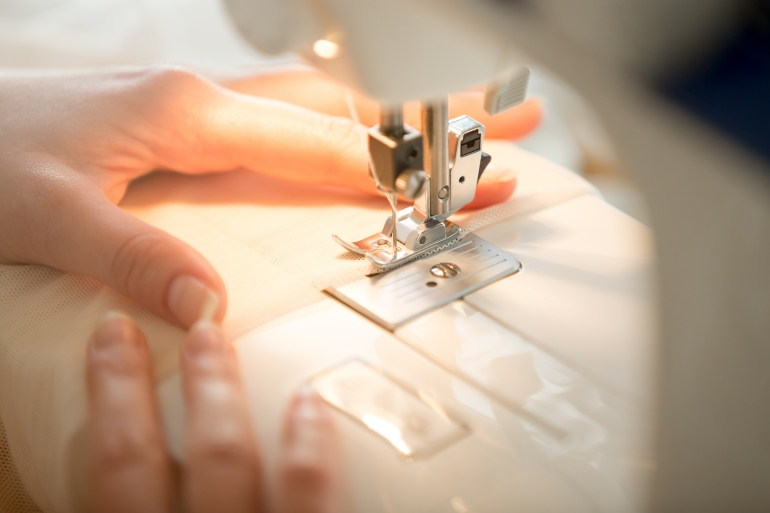 Hands at sewing machine
